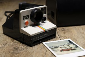 Polaroid instant photos camera, one for the Xennials