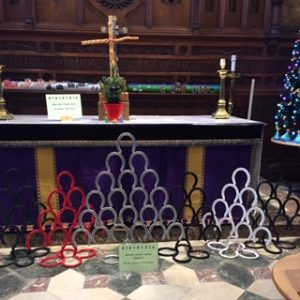 6 Christmas trees made from horseshoes. Different colours.