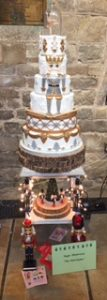 Tiered white cake with Nutcracker theme.