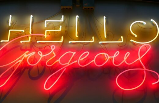Yellow and red illuminated sign saying Hello Gorgeous.